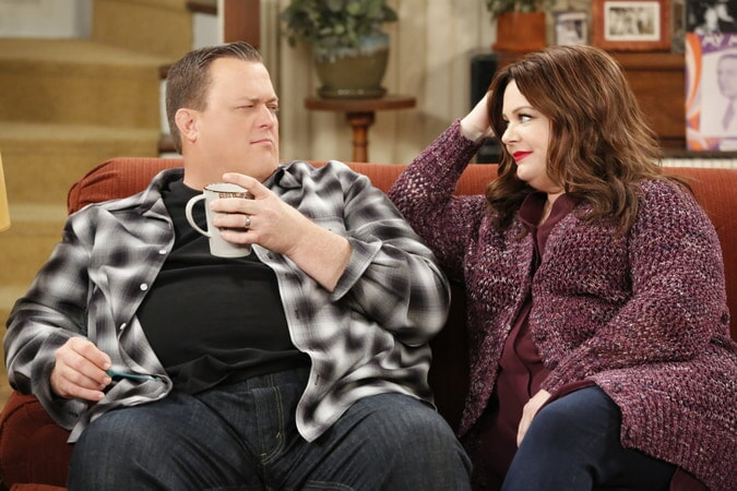 Mike and Molly sitting on couch together (Season 6)