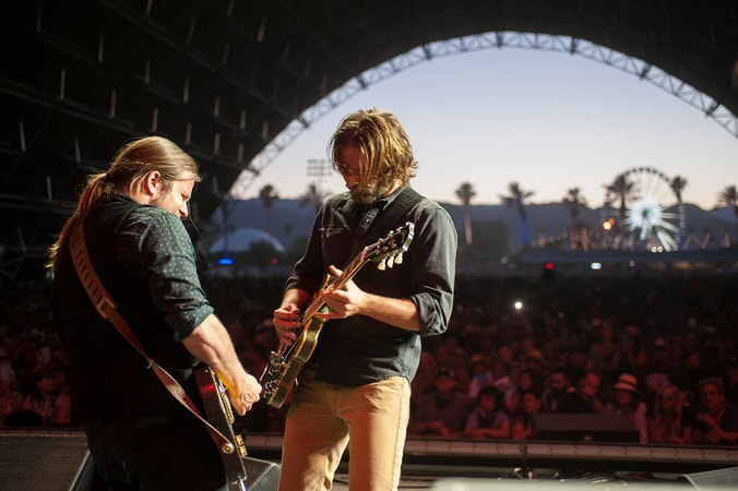 LUKAS NELSON as guitarist and BRADLEY COOPER as Jack