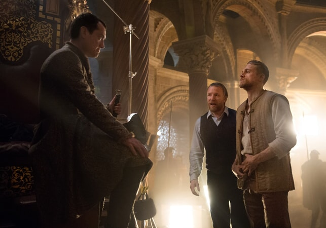 """JUDE LAW, director/screenwriter/producer GUY RITCHIE and CHARLIE HUNNAM on the set of Warner Bros. Pictures' and Village Roadshow Pictures' fantasy action adventure """"KING ARTHUR: LEGEND OF THE SWORD,"""" distributed worldwide by Warner Bros. Pictures and in select territories by Village Roadshow Pictures."""
