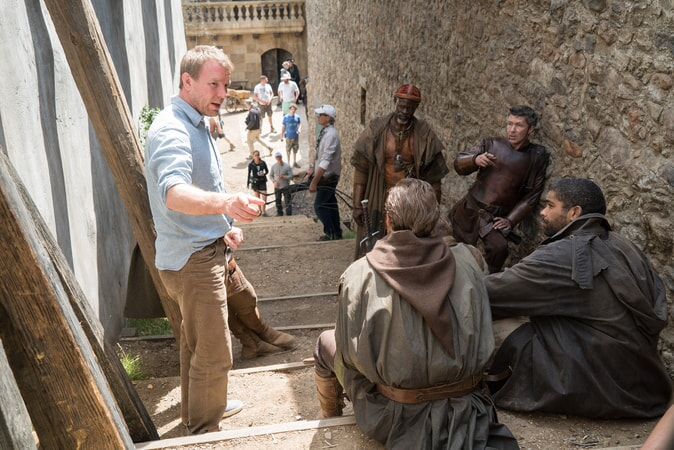 """Director/screenwriter/producer GUY RITCHIE, CHARLIE HUNNAM, KINGSLEY BEN-ADIR, AIDAN GILLEN and DJIMON HOUNSOU on the set of Warner Bros. Pictures' and Village Roadshow Pictures' fantasy action adventure """"KING ARTHUR: LEGEND OF THE SWORD,"""" distributed worldwide by Warner Bros. Pictures and in select territories by Village Roadshow Pictures."""