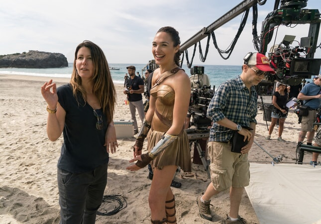"(Foreground L-R) Director PATTY JENKINS and GAL GADOT on the set of the action adventure ""WONDER WOMAN,"" a Warner Bros. Pictures release."
