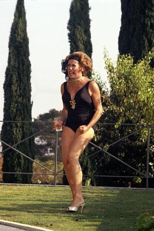 angry, drunken Janet Ward as Arlene Iverson, wearing bathing suit, holding drink.
