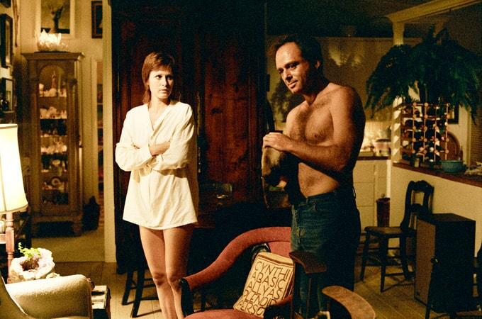 Susan Clark as Ellen Moseby and shirtless Harris Yulin as Marty Heller.