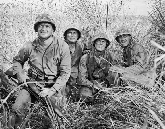 "Medium shot of Aldo Ray as Andy Hookens, Perry Lopez as Joe Gomez, Tab Hunter as Dan, ""Danny"" Forrester, and James Whitmore as Sergeant Mac/Narrator, all holding guns/rifles and wearing helmets, uniforms."