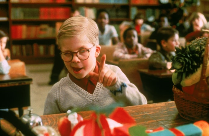 """Ralphie giving the """"finger gun"""" in front of his classroom"""