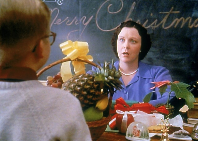 Miss Shields with look of confusion accepting fruit basket from Ralphie