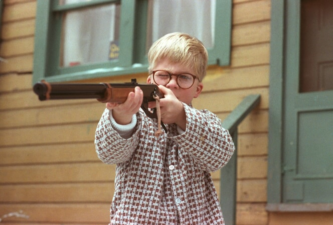 Ralphie in pajamas shooting BB gun