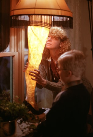 Mrs. Parker and Ralphie looking at lit leg lamp