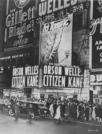 Full shot of moviegoers, lined up at premiere in New York's Palace Theatre on May 1, 1941.