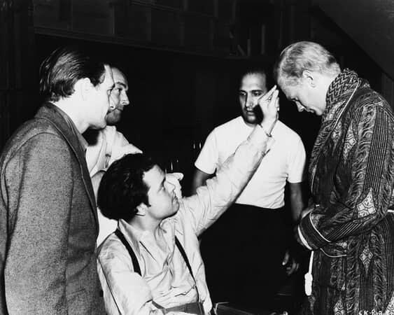 BTS shot of cinematographer Gregg Toland, assistant director Eddie Donahoe, director Orson Welles as Charles Foster Kane, makeup artist Maurice Seiderman and Joseph Cotten as Jedediah Leland.