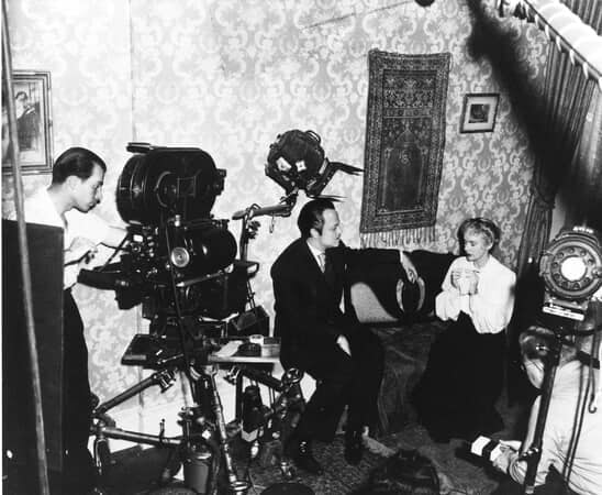 BTS shot of director Orson Welles as Charles Foster Kane; with Dorothy Comingore as Susan Alexander; and film crew.