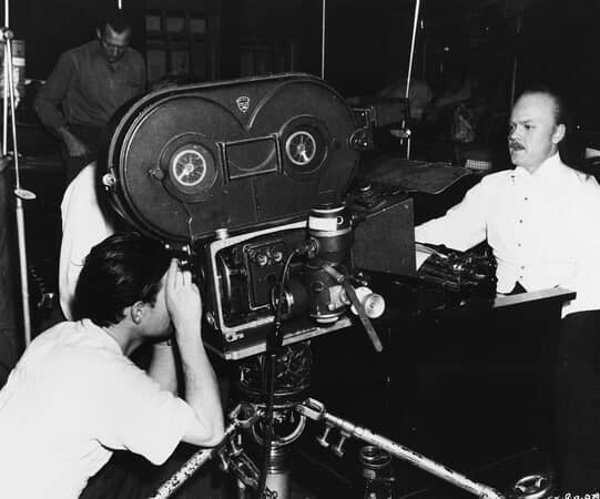 BTS shot of cinematographer Gregg Toland filming close-up of director Orson Welles as Charles Foster Kane.