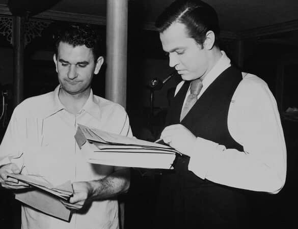 BTS shot of assistant director Eddie Donahoe and director Orson Welles as Charles Foster Kane, reviewing papers.