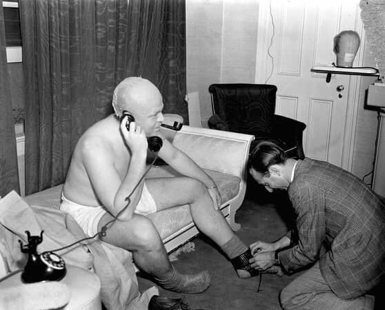 BTS shot of Orson Welles as Charles Foster Kane inside dressing room.
