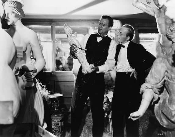 Full shot of Joseph Cotten as Jedediah Leland and Everett Sloane as Bernstein looking at statues.