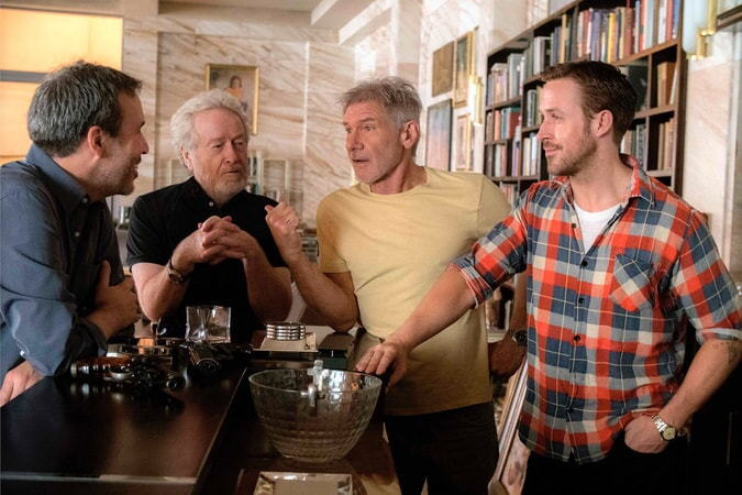 Director Denis Villeneuve, executive producer (and original Blade Runner director) Ridley Scott, Harrison Ford and Ryan Gosling on the set of Alcon Entertainment's Blade Runner 2049, a Warner Bros. Pictures Release. (Photo by: Stephen Vaughan)