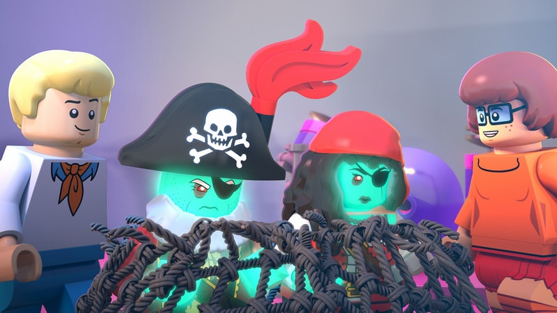 fred and velma pictured in LEGO Scooby-Doo: Blowout Beach Bash