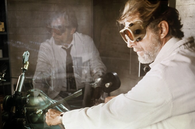 Fritz Weaver as Alex Harris wearing goggles in demon seed