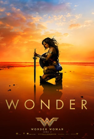 "Wonder Woman kneeling on beach with sword with caption ""WONDER"" beneath her"