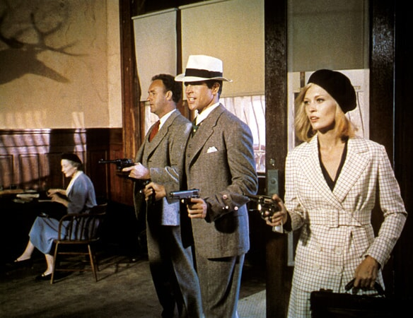 gene hackman, warren beatty and faye dunaway in a bank heist scene in bonnie and clyde