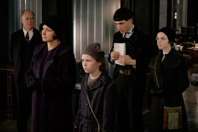 "SAMANTHA MORTON as Mary Lou Barebone, FAITH WOOD-BLAGROVE as Modesty, EZRA MILLER as Credence and JENN MURRAY as Chastity in Warner Bros. Pictures' fantasy adventure ""FANTASTIC BEASTS AND WHERE TO FIND THEM,"" a Warner Bros. Pictures release."