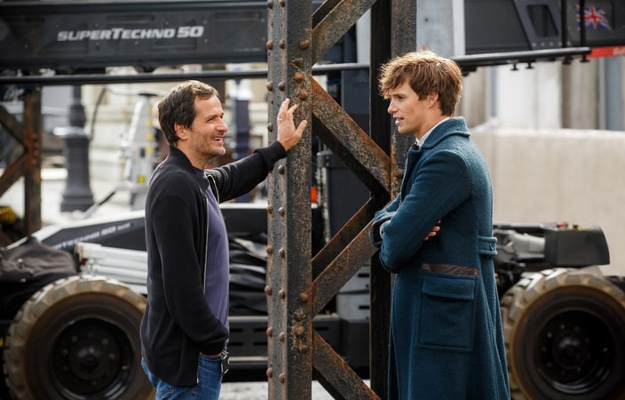 """Producer DAVID HEYMAN and EDDIE REDMAYNE on the set of Warner Bros. Pictures' fantasy adventure """"FANTASTIC BEASTS AND WHERE TO FIND THEM,"""" a Warner Bros. Pictures release."""