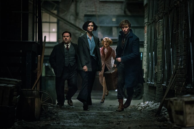 "DAN FOGLER as Jacob, KATHERINE WATERSTON as Tina, ALISON SUDOL as Queenie and EDDIE REDMAYNE as Newt in Warner Bros. Pictures' fantasy adventure ""FANTASTIC BEASTS AND WHERE TO FIND THEM,"" a Warner Bros. Pictures release."