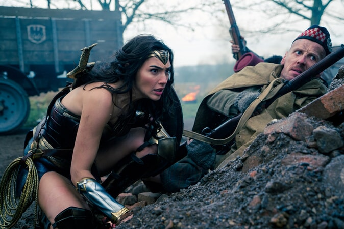 "GAL GADOT as Diana and EWEN BREMNER as Charlie in the action adventure ""WONDER WOMAN,"" a Warner Bros. Pictures release."