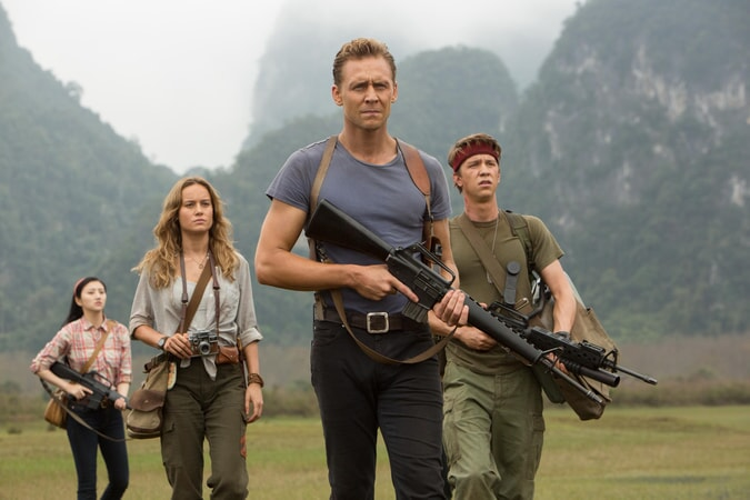 "JING TIAN as San, BRIE LARSON as Mason Weaver, TOM HIDDLESTON as James Conrad and THOMAS MANN as Slivko in Warner Bros. Pictures', Legendary Pictures' and Tencent Pictures' action adventure ""KONG: SKULL ISLAND,"" a Warner Bros. Pictures release."