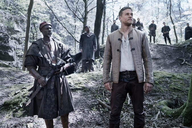 "DJIMON HOUNSOU as Bedivere and CHARLIE HUNNAM as Arthur in Warner Bros. Pictures' and Village Roadshow Pictures' fantasy action adventure ""KING ARTHUR: LEGEND OF THE SWORD,"" distributed worldwide by Warner Bros. Pictures and in select territories by Village Roadshow Pictures."
