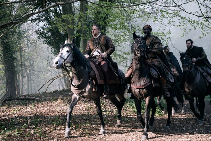 """CHARLIE HUNNAM as Arthur, DJIMON HOUNSOU as Bedivere, KINGSLEY BEN-ADIR as Wet Stick and CRAIG McGINLAY as Percival in Warner Bros. Pictures' and Village Roadshow Pictures' fantasy action adventure """"KING ARTHUR: LEGEND OF THE SWORD,"""" distributed worldwide by Warner Bros. Pictures and in select territories by Village Roadshow Pictures."""