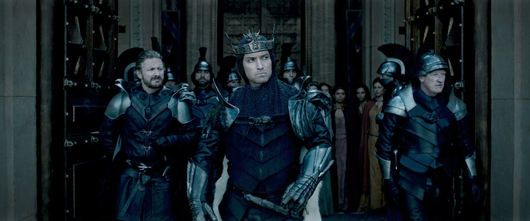 """PETER FERDINANDO as Earl of Mercia, JUDE LAW as Vortigern and GEOFF BELL as Mischief John in Warner Bros. Pictures' and Village Roadshow Pictures' fantasy action adventure """"KING ARTHUR: LEGEND OF THE SWORD,"""" distributed worldwide by Warner Bros. Pictures and in select territories by Village Roadshow Pictures."""