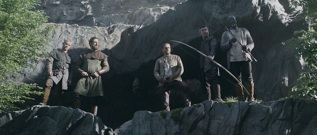 "FREDDIE FOX as Ed, CRAIG McGINLAY as Harry, CHARLIE HUNNAM as Arthur, AIDAN GILLEN as Bill and DJIMON HOUNSOU as Bedivere in Warner Bros. Pictures' and Village Roadshow Pictures' fantasy action adventure ""KING ARTHUR: LEGEND OF THE SWORD,"" distributed worldwide by Warner Bros. Pictures and in select territories by Village Roadshow Pictures."
