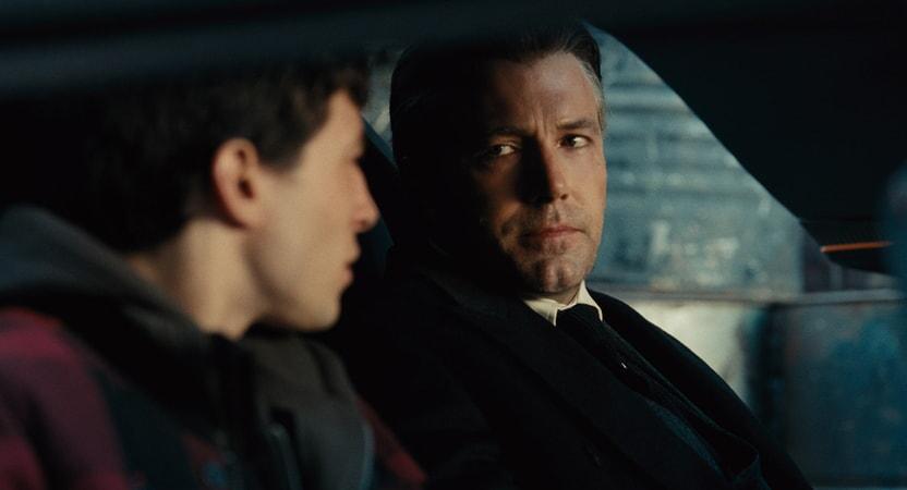 """EZRA MILLER as Barry Allen and BEN AFFLECK as Bruce Wayne in Warner Bros. Pictures' action adventure """"JUSTICE LEAGUE,"""" a Warner Bros. Pictures release."""