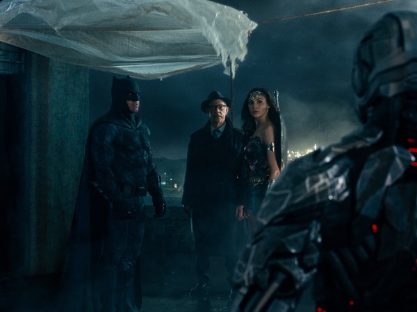 "BEN AFFLECK as Batman, J.K. SIMMONS as Commissioner Gordon, GAL GADOT as Wonder Woman and RAY FISHER as Cyborg in Warner Bros. Pictures' action adventure ""JUSTICE LEAGUE,"" a Warner Bros. Pictures release."