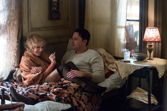 "SIENNA MILLER as Emma Gould and BEN AFFLECK as Joe Coughlin in Warner Bros. Pictures' dramatic crime thriller ""LIVE BY NIGHT,"" a Warner Bros. Pictures release."