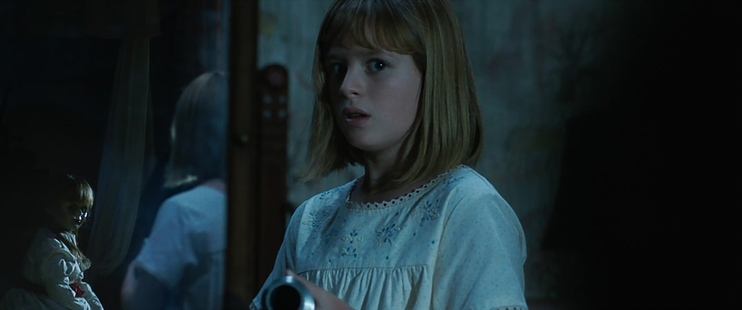 "The Annabelle doll and LULU WILSON as Linda in New Line Cinema's supernatural thriller ""ANNABELLE: CREATION,"" a Warner Bros. Pictures release."