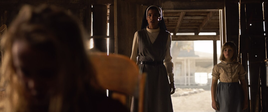 "STEPHANIE SIGMAN as Sister Charlotte and LULU WILSON as Linda in New Line Cinema's supernatural thriller ""ANNABELLE: CREATION,"" a Warner Bros. Pictures release."
