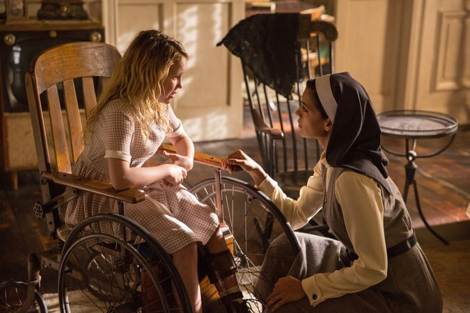 "TALITHA BATEMAN as Janice and STEPHANIE SIGMAN as Sister Charlotte in New Line Cinema's supernatural thriller ""ANNABELLE: CREATION,"" a Warner Bros. Pictures release."