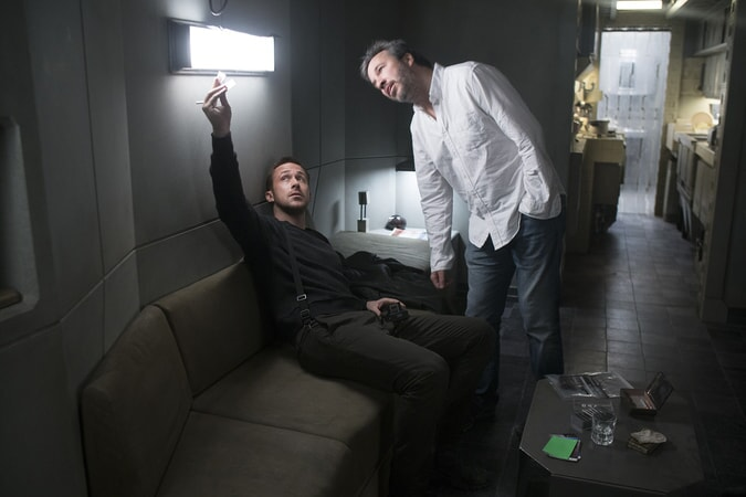 "RYAN GOSLING and director DENIS VILLENEUVE on the set of Alcon Entertainment's action thriller ""BLADE RUNNER 2049,"" a Warner Bros. Pictures and Sony Pictures Entertainment release, domestic distribution by Warner Bros. Pictures and international distribution by Sony Pictures."