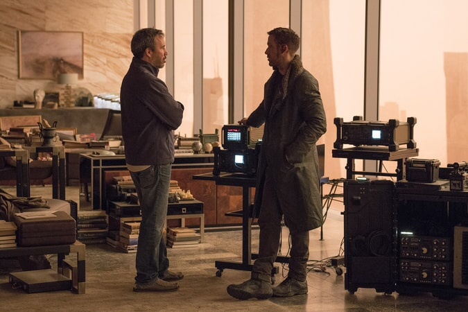 "Director DENIS VILLENEUVE and RYAN GOSLING on the set of Alcon Entertainment's action thriller ""BLADE RUNNER 2049,"" a Warner Bros. Pictures and Sony Pictures Entertainment release, domestic distribution by Warner Bros. Pictures and international distribution by Sony Pictures."