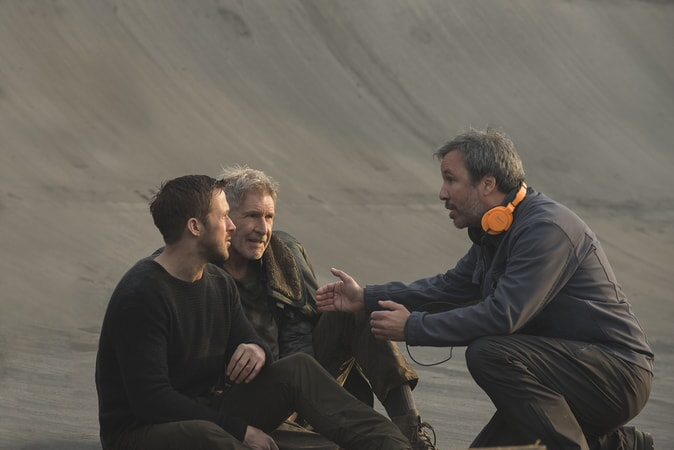 "RYAN GOSLING, HARRISON FORD and director DENIS VILLENEUVE on the set of Alcon Entertainment's action thriller ""BLADE RUNNER 2049,"" a Warner Bros. Pictures and Sony Pictures Entertainment release, domestic distribution by Warner Bros. Pictures and international distribution by Sony Pictures."