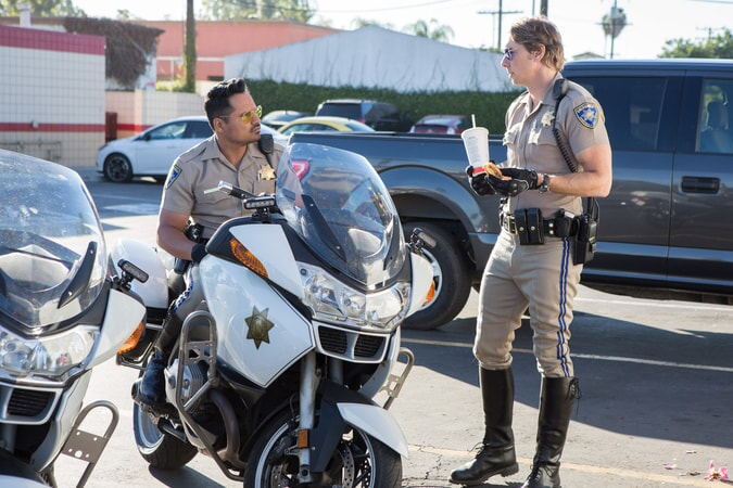 "MICHAEL PEÑA as Ponch and DAX SHEPARD as Jon in Warner Bros. Pictures' action comedy ""CHIPS,"" a Warner Bros. Pictures release."