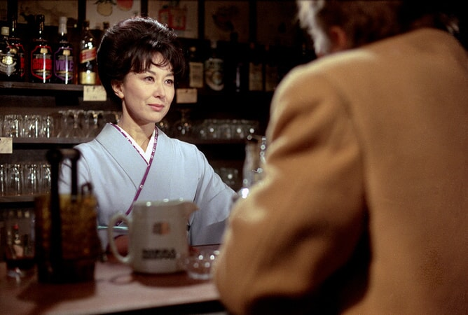 Keiko Kishi as Eiko in the yakuza