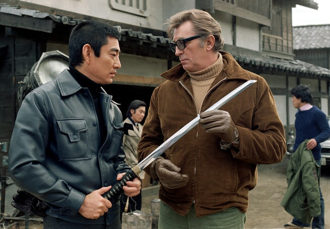 Takakura Ken and robert mitchum on the set of the yakuza.