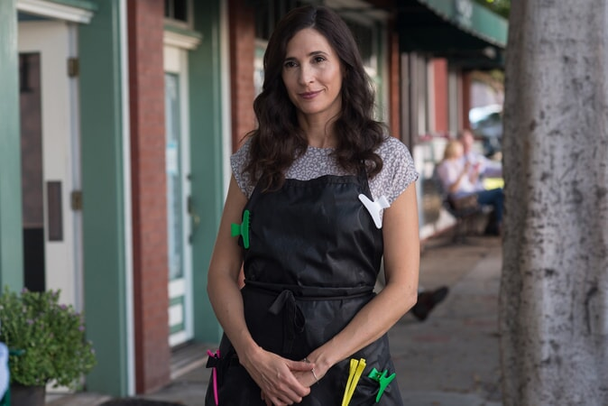 """MICHAELA WATKINS as Raina in the New Line Cinema and Village Roadshow Pictures comedy """"THE HOUSE,"""" a Warner Bros. Pictures release."""