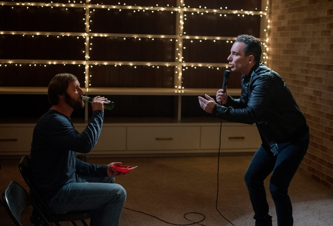 """RORY SCOVEL as Joe and SEBASTIAN MANISCALCO as Stand-up Comic in the New Line Cinema and Village Roadshow Pictures comedy """"THE HOUSE,"""" a Warner Bros. Pictures release."""
