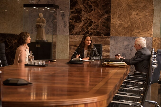 """(L-R) KRISTIN SCOTT THOMAS as Ana Miller, ALICIA VIKANDER as Lara Croft and DEREK JACOBI as Mr. Yaffe in Warner Bros. Pictures' and Metro-Goldwyn-Mayer Pictures' action adventure """"TOMB RAIDER,"""" a Warner Bros. Pictures release."""