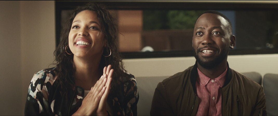 "KYLIE BUNBURY as Michelle and LAMORNE MORRIS as Kevin in New Line Cinema's action comedy ""GAME NIGHT,"" a Warner Bros. Pictures release."