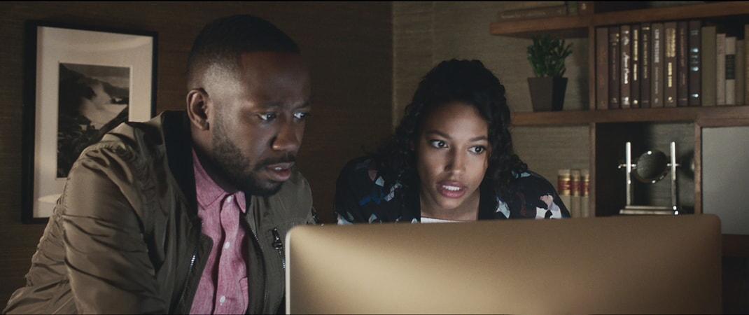 "LAMORNE MORRIS as Kevin and KYLIE BUNBURY as Michelle in New Line Cinema's action comedy ""GAME NIGHT,"" a Warner Bros. Pictures release."